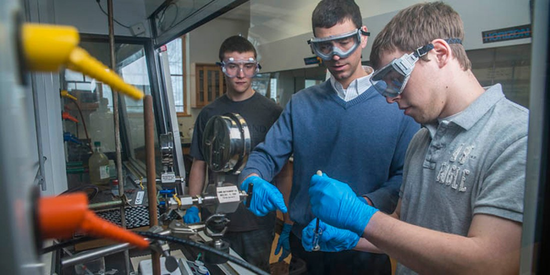 Northland College's Nicholas Robertson, assistant professor of chemistry, center, instructs undergraduate researchers Tyler Klein, left, and Ryan Andersen.